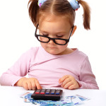 Little girl plays with money_classiblogger_image